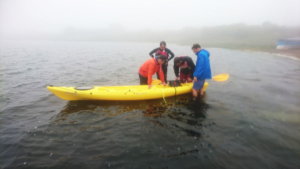 On a lake with a kayak based, hubless onboard motot prototype research and development.
