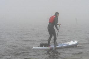 On a lake with a paddleboard based, hubless onboard motot prototype research and development.